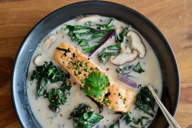 Coconut soup with salmon and kale